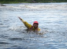 Man. KOLSKYY, RUSSIA - 17 August 2008: The man fell out of the catamaran during their difficult threshold mountain river Stock Images