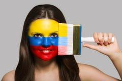 Kolumbijska flaga malująca na twarzy Zdjęcia Stock