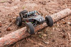 Kolyazin, Moscow region / Russian Federation - May 1 2014: RC car crowler Vaterra Twin Hammers does not overcome the stock photography