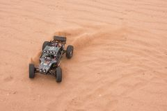 Kolyazin, Moscow region / Russian Federation - May 1 2014: RC car crowler Vaterra Twin Hammers driving through the sand royalty free stock photography
