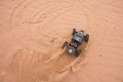 Kolyazin, Moscow region / Russian Federation - May 1 2014: RC car crowler Vaterra Twin Hammers driving through the sand royalty free stock image