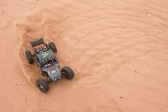 Kolyazin, Moscow region / Russian Federation - May 1 2014: RC car crowler Vaterra Twin Hammers driving through the sand royalty free stock photos