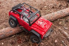 Kolyazin, Moscow region / Russian Federation - May 1 2014: RC car trophy crowler Jeep moves over an obstacle in the form stock images