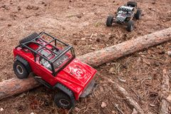 Kolyazin, Moscow region / Russian Federation - May 1 2014: RC cars trophy crowler Jeep and Vaterra Twin Hammers moves stock photo
