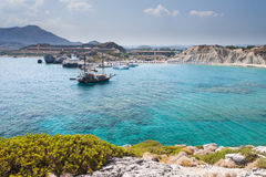 Kolymbia beach with the rocky coast with boat. Stock Photo