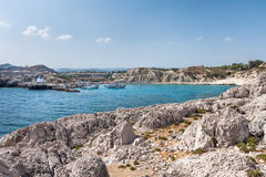 Kolymbia beach with the rocky coast Royalty Free Stock Image