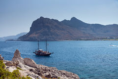 Kolymbia beach with the rocky coast in Greece. Stock Image