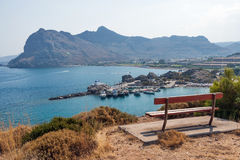 Kolymbia beach with the rocky coast in Greece. Stock Image
