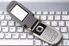 komórki notatnika telefon Zdjęcia Stock