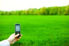 komórki ręki telefon Zdjęcia Royalty Free
