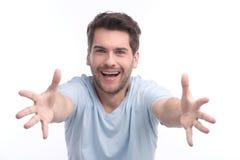 Kom aan me! Portret van gelukkige jonge mensen die op camera gesturing whil Royalty-vrije Stock Afbeeldingen