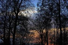 kom den övre vintern för dimmasolnedgången Arkivfoton