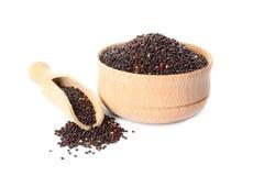Kom en lepel met zwarte quinoa stock afbeelding
