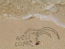 Kom goed op strandzand Stock Foto's