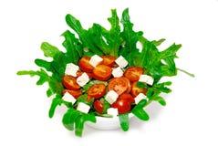 Kom Griekse geïsoleerden salade Royalty-vrije Stock Afbeeldingen
