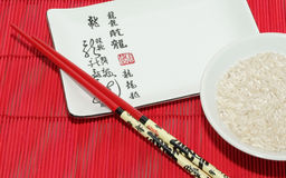 Kom rijst met eetstokjes Stock Fotografie