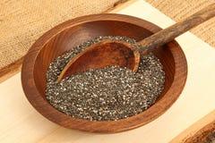 Kom van Chia Seeds With Spoon Stock Afbeeldingen