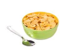 Kom van cornflakes met lepel Stock Foto