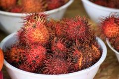 Kom van Rambutan stock foto