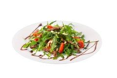 Kom verse rucolasalade met kersentomaten Stock Foto