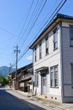 Komaba gammal shoppinggata i den Achi byn, sydliga Nagano, Japan Royaltyfria Bilder