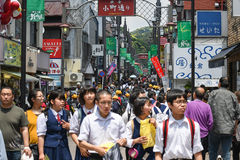 Komachi street, Karamura, Japan. Karamura, Japan - May 18, 2017: Many people are walking along shops and stores at Komachi street, a famous shopping street in royalty free stock images