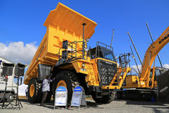 Komatsu HD605 Rigid Dump Truck on Test. HYVINKAA, FINLAND - SEPTEMBER 11, 2015: Unnamed men demonstrating Komatsu HD605 Rigid dump truck for mining at MAXPO 2015 Royalty Free Stock Photos