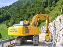 Komatsu PC 230 NHD new excavator in operation. stock photos