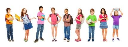 Kombinacja szkolni mądrzy dzieciaki na bielu Obraz Royalty Free