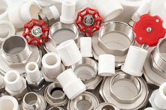 kombinerade monteringar pipe unioner Arkivfoton