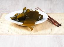 Kombu Kelp - Alga Kombu. Kombu kelp is a large brown algae seaweed. Binomial name: Laminaria Ochroleuca. It is an edible seaweed used extensively in Japanese royalty free stock photography
