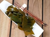 Kombu Kelp - Alga Kombu. Kombu kelp is a large brown algae seaweed. Binomial name: Laminaria Ochroleuca. It is an edible seaweed used extensively in Japanese stock photography