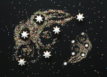 Komet von Weihnachtsplätzchen und -süßigkeit färbte Belag Stockbild