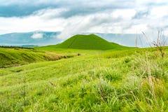 Komezuka volcanic cone in Mt. Aso Area. Komezuka is a small, beautifully shaped volcanic cone on the northern slopes of Nakadake, Japan. There are pleasant stock image