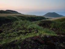 Komezuka volcanic cone after sunset - in Aso caldera, Kumamoto prefecture, Japan. Komezuka volcanic cone after sunset - in Aso caldera, part of Aso-Kuju National stock images