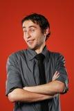 Komiczny młody człowiek na czerwieni Zdjęcia Royalty Free