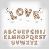 Komische Karikaturschokolade mit Buchstaben des Süßigkeitsherz-Alphabetes 3d Stockbilder