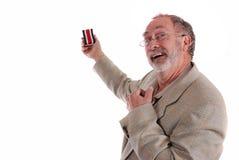 Komischer Professor, der mit weißem Tafelreiniger gestikuliert Stockbild
