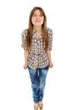 Komisches junges weibliches Lächeln gegen Stockbilder