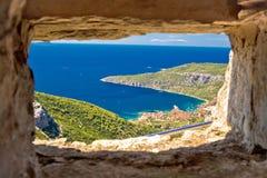 Komiza bay aerial view through stone window Royalty Free Stock Images