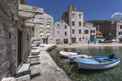 Komiza on island Vis. Buildings at shore in town Komiza on island Vis, Croatia Royalty Free Stock Photo