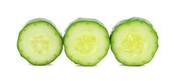 Komkommer en plakken over witte achtergrond Royalty-vrije Stock Fotografie