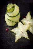 Komkommer en starfruit Stock Fotografie