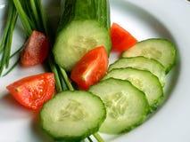Komkommer en tomaten Stock Fotografie