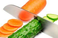 Komkommer en wortel stock foto's