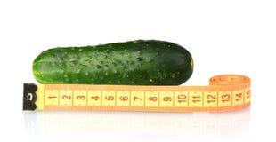 Komkommer met het meten van band Stock Foto's