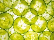 Komkommerplakken worden aangestoken die van onderaan Stock Foto's
