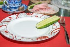 Komkommers bij plaat Royalty-vrije Stock Foto
