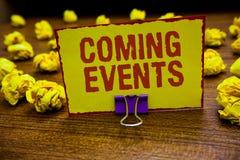 Kommande händelser för ordhandstiltext Affärsidé för att hända snart kommande planerat möte som är kommande i det framtida geminn royaltyfri fotografi