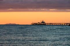 Kommersiell skeppsdocka på solnedgång Fotografering för Bildbyråer